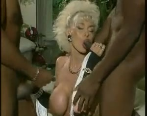 German blonde milf with big tits gets 2 BBC's